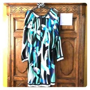 Perfect dress for a wedding or cruise. 95% silk